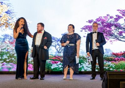 STEPS Pathways College students on stage at the Grand Winter Ball with Paulini